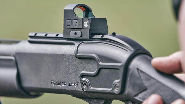 Close up of Bushnell RXS-100 Reflex Sight mounted on a shotgun