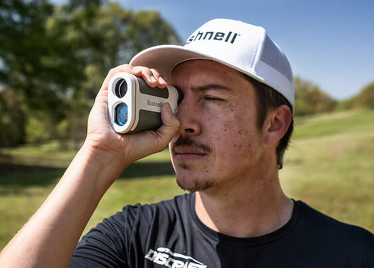 Man looking through Bushnell Edge Laser Rangefinder eyepiece