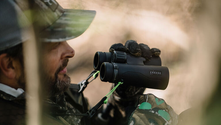 Hunter with the Bushnell Engage DX Binoculars in hand