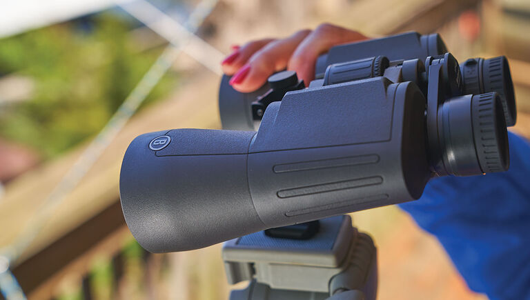 Woman holding the Bushnell Powerview 2 Binoculars