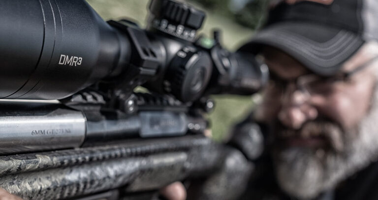 Shooter aiming through Elite Tactical DMR3 Riflescope