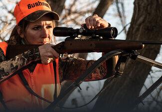 Hunter aiming and adjusting Bushnell Prime Riflescope