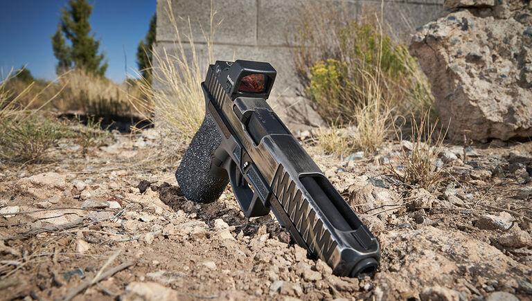 Bushnell RXS-250 Reflex Sight mounted on a pistol that's on the ground