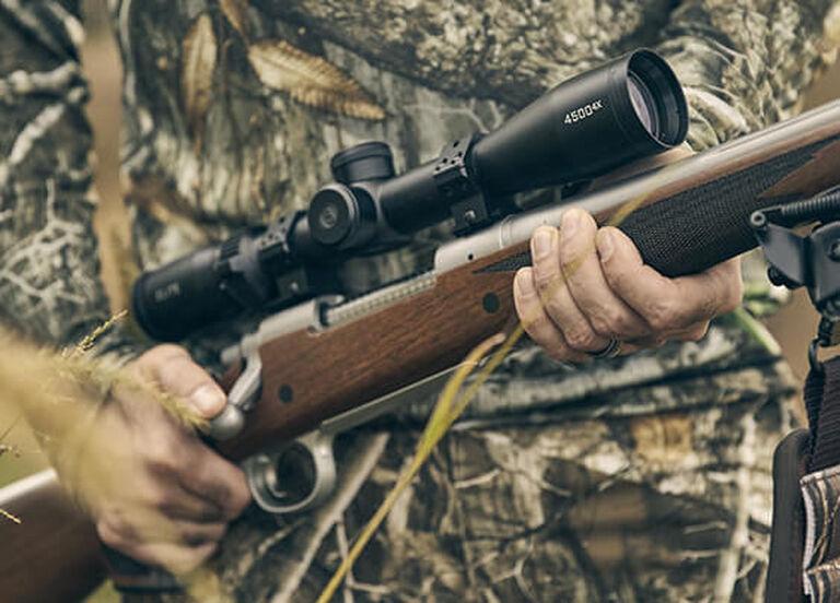 Hunter holding rifle with Elite 4500 scope