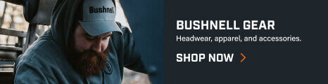 Man wearing Bushnell hat and hoodie