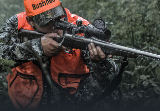Hunter aiming through Bushnell Engage Riflescope in the rain