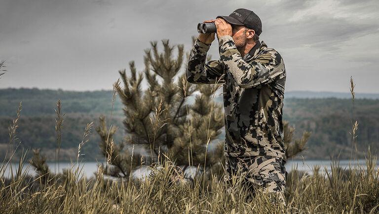 Hunter looking through the Bushnell Engage DX Binoculars