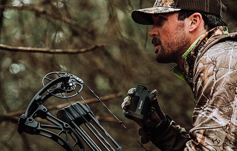 Bow hunter holding Prime 1800