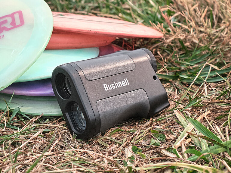 Bushnell Sport 850 laying in grassy field