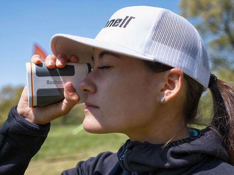Woman looking through Bushnell Edge Laser Rangefinder eyepiece