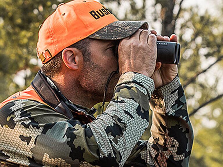 Hunter looking through Bushnell Engage EDX Binoculars