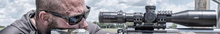 Disc Golfer looking through Bushnell Edge Rangefinder