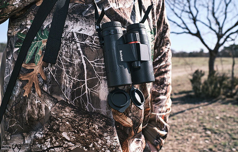Hunter wearing Nitro Binoculars with neck straps