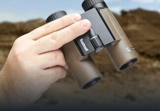 Hand holding Bushnell Forge 10x30 Binoculars
