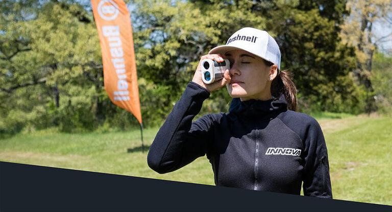 Woman using Edge Disc Golf Rangefinder